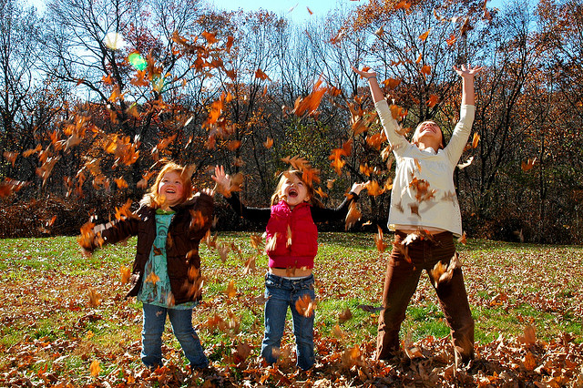 kids playing in fall