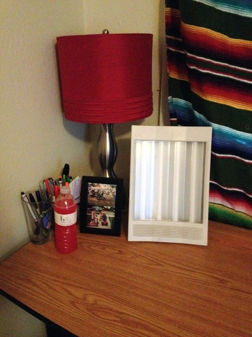NatureBright SunTouch Plus Light and Ion Therapy Lamp on desk