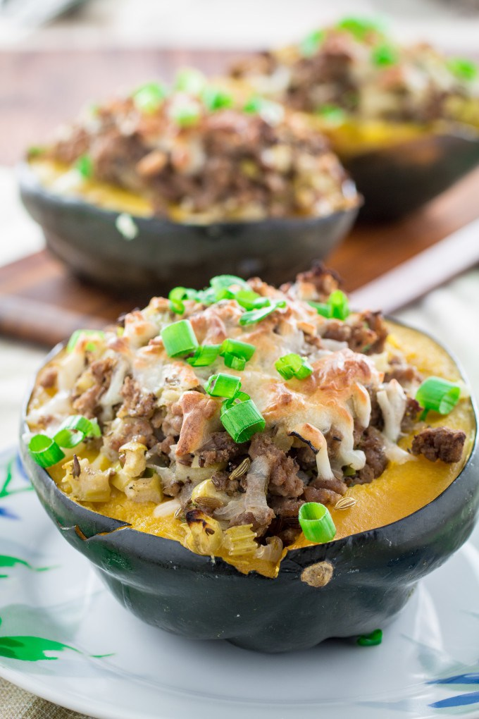 low carb recipe Acorn Squash Stuffed with Turkey Sausage by food blogger Dining Delish
